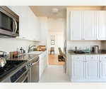 Impeccable Two Bedroom / Two Bath * Curved Wall of Glass * Dining Area * UES