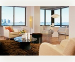 WATER VIEWS! Ideally situated Battery Park City one bed in luxury, full service building