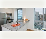 Midtown West 2 Bedroom / 2 Bathroom with Balcony. Floor-to-Ceiling Windows. Close to Penn Station, Herald Square, Madison Square Garden. Available Immediately. No Broker Fee.